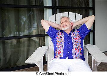 senior relaxing on the veranda
