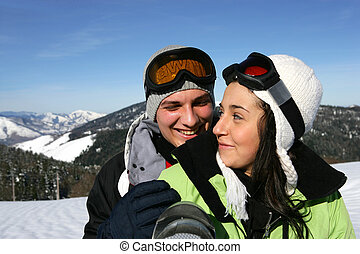 Young couple on a ski slope