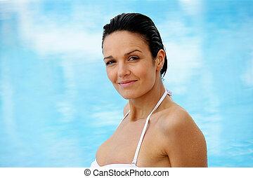 Beautiful woman in a swimming-pool