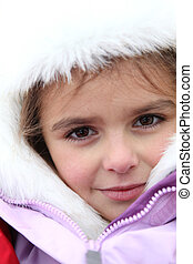 little girl dressed with warm clothes