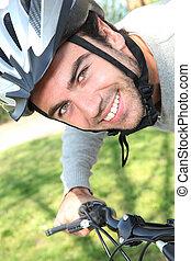 Young man having a bike ride