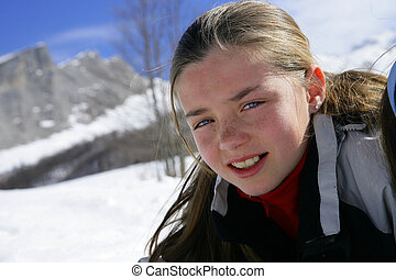 Girl on a snowy mountain