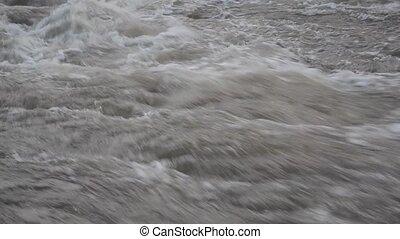Fast flowing dark wild water