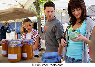 Young people shopping in a market
