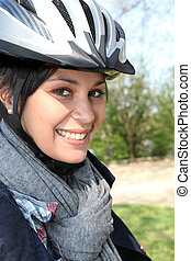 Young woman in a cyclist helmet