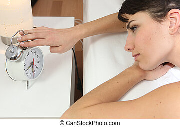 Girl turning off her clock