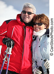 Portrait of a couple on a skiing holiday