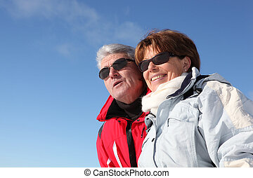 Retired couple in ski wear