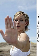 Woman holding her hand out to say stop