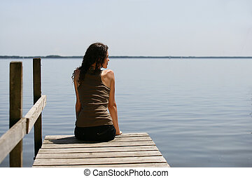 Woman sitting on a pontoon