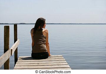 Woman sitting on a pontoon