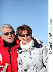 Adult couple skiing
