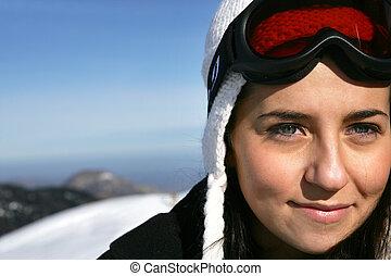 Woman stood on snowy mountain
