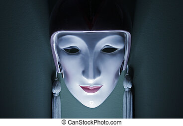Ceramic mask - Ghostly appearance of a ceramic mask hanging...