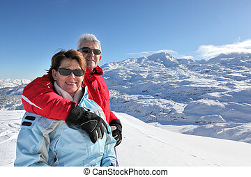 Middle-aged couple on skiing holiday