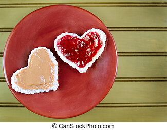 Heart shape peanut butter and jelly sandwtich - A heart...