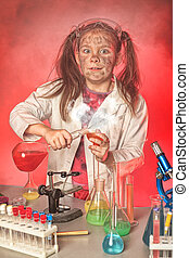 fire experiment - Little girl is making science experiments...