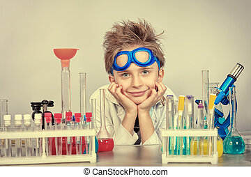 dream science - Little boy is making science experiments....