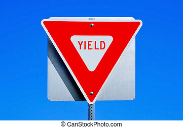yield sign - a yield traffic sign in a road