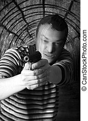 Black dressed man with gun in the tunnel