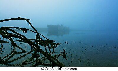 Spooky Shipwreck Valdez Alaska - beached barge silhouetted...