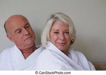 senior couple wearing bathrobes relaxing