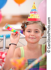 portrait of a little girl at birthday party