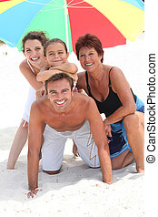 Family holidaying on a sandy beach
