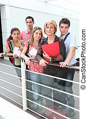 Teacher standing with students