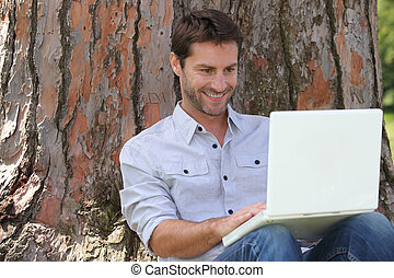 portrait of a man with laptop