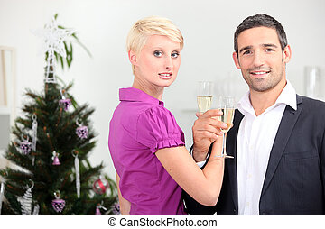 Couple drinking champagne at Christmas