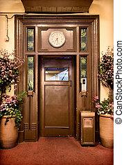 old elevator door - old vintage elevator door in the lobby