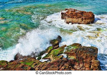 ocean waves on rocks