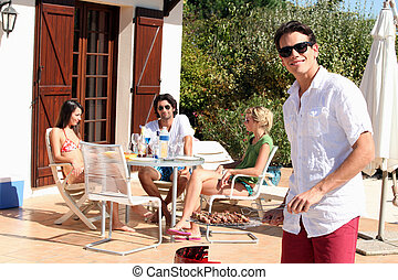 Friends having a barbecue on a sunny day