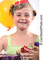 portrait of a little girl with presents