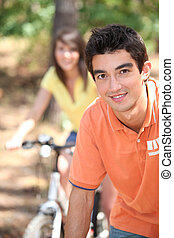 close-up of a young man on a bike