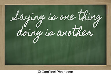 handwriting blackboard writings - Saying is one thing, doing...