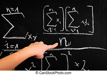 Hand of a girl pointing at chalkboard