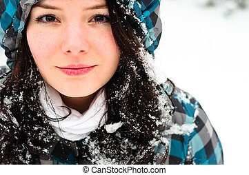 Young woman with snow in her hair