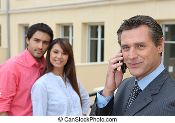 Young couple viewing a property with an agent