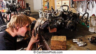 Worker Repairing car motor