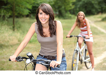 portrait of two girls on bikes