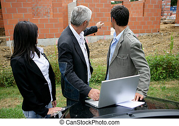 property developer with young couple