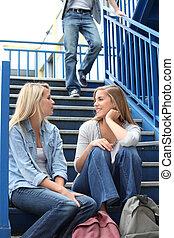 School girls talking on steps