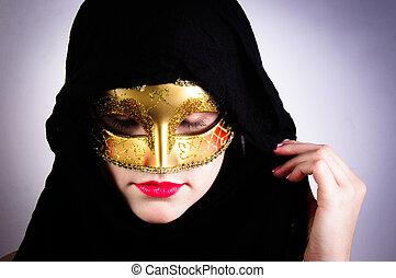 Closeup photo of a woman in black hood and red lips