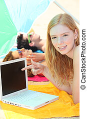 pretty girl pointing her laptop while her friends are...