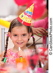 Little girl at a birthday party