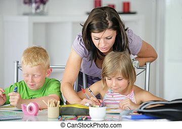 mother helping her kids with the homework