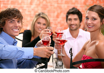 2 couples enjoying meal together