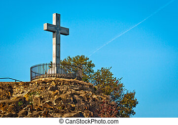 Stone cross at the top of a mountain